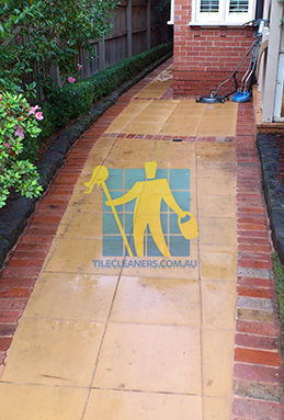 outdoor sandstone tiles pavers wet from cleaning with quarry tiles around Woodville