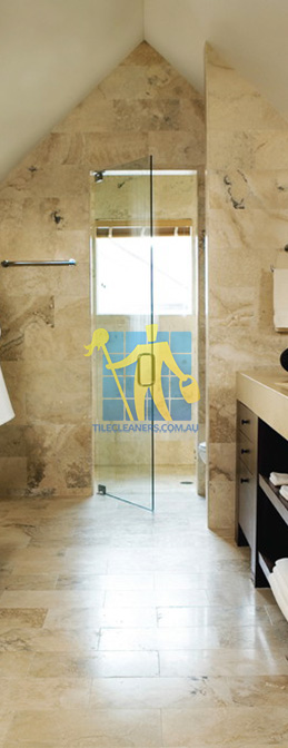 travertine tiles bathroom floor wall shower with dark veining Mitcham